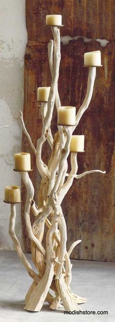 Select pieces of driftwood are re-purposed to create this dramatic candelabra. Wind and waves began the weathering process of driftwood. We completed it by blea