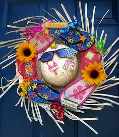 Flip flop wreath on a straw hat with sunglasses. Everything was bought at Dollar Tree! Aloha! :)