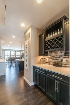 This butler's pantry is a great place for your bar items with a wine rack and glass holders, and is also useful for extra storage. Seen in the Keller model at Shadowood located in Bargersville, Indiana. | Fischer Homes
