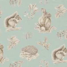 Squirrel & Hedgehog Linen Fabric A sweet fabric featuring a squirrel, rabbit and hedgehog set amongst sprays of natural British flora, acorns, catkins and blackberries. Pencil drawn in fine detail and printed in dark green on a powder blue ground.