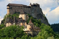 Orva Castle, Slovakia.  Situated  on a high rock, (also called the Eagle Nest).  The castle is considered to be the largest and most beautiful castle in Slovakia.  Open for tours.    However, this is another photo of the castle that I referred to in another pin on this board.  It is shown in a thunderstorm and being located in France.  D. Martin