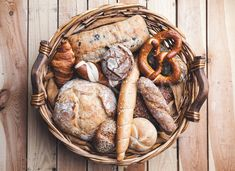 A basket full of delicious fresh bread on wooden background stock photo (c) tommyandone (#8453629) | Stockfresh