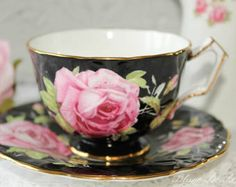Aynsley Regd. No. 765788, England:  Fabulous black crocus tea cup and saucer, with a beautiful cabbage pink rose