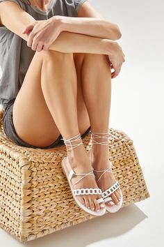 Phoebe is the new style of gladiator sandals from our chain collection and we are so in love with them! These dreamy sandals are handmade of top quality leather in white and feature one asymmetrical woven strap along the toes and a toe ring for a secure fit. They fasten with skinny ties that wrap elegantly around the ankle. They're so unique yet so versatile, they will complement everything from jeans to dresses. These flats are also available in 3 more fashion colors, camel/brown, gold…