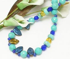 Golden topaz and deep cobalt blues meets with blue turquoise colors in this striking turquoise colored faceted round magnesite and Czech glass beaded necklace. #cpromo