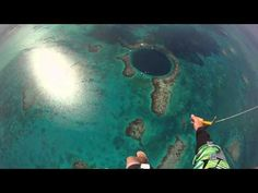 Skydiving into the Blue Hole, Belize - YouTube (OH MY GASSSHHHHH HE FLIES THROUGH A CLOUD)