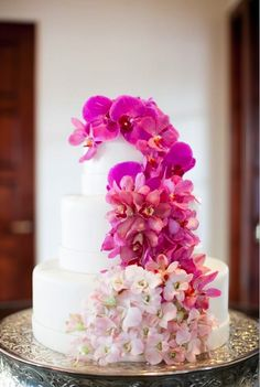 ombre pink wedding cake with different varieties of orchids