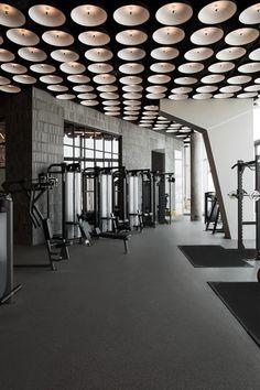 Fitness Center, Lifestyle Designs: The Warehouse Gym, Dubai - Love That Design Warehouse Gym, Gym Center, Yoga Studio Design, Gym Interior, Concrete Bricks, Home Gym Design, Gym Room, Glass Facades, Fitness Design