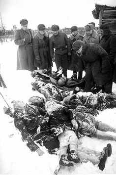 Red Army soldiers view the tortured bodies of civilians - women, children and old people -- massacred by the Germans in Krasnogvardeisk region, 1944.