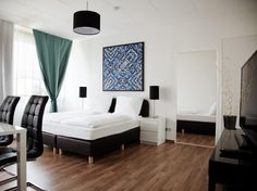 Berlin K26 Apartments Germany, Europe Stop at K26 Apartments to discover the wonders of Berlin. The hotel offers a wide range of amenities and perks to ensure you have a great time. Service-minded staff will welcome and guide you at the K26 Apartments. Guestrooms are fitted with all the amenities you need for a good night's sleep. In some of the rooms, guests can find closet, complimentary tea, towels, separate living room, television LCD/plasma screen. The hotel offers variou...