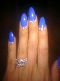 blue almond nails with rhinestoned details
