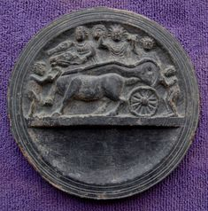 """Many Gandharan """"cosmetic trays"""" display events from the life of the Buddha, and one suspects that many of such trays were actually keepsakes or trinkets.  This rare dish also seems to record young Prince Siddhartha going to school.  The dish is about 12.8 cm diameter."""
