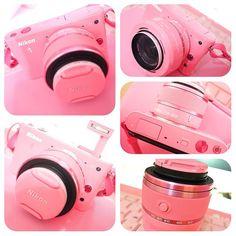 Nikon J1 pink. My dream camera. must have ya kalo punyaa free money ..