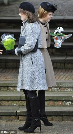 (R-L) Princess Beatrice and sister Princess Eugenie receive flowers outside of St. Mary's church