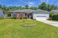 7009 Brittany Lakes Dr. Wilmington, NC 28411       MLS: 525463     Bedrooms: 3     Baths: 2     Partial Baths: 0     SQ FT: 1936     Lot Size: .25     Style: Ranch     Garage: 2 Car     Heat Source: Electric     Schools: New Hanover (Elementary School: Murrayville; Middle School: Trask; High School: Laney)