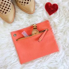 "✨HP✨ Neon Coral Faux Leather Clutch Neon coral faux leather clutch with gold hardware. Perfect size to hold phone, lipstick and some cash. Measures approx. 6x8"". Never used, perfect condition and great color for summer! ✨ Host Pick 