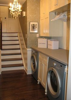 I like the hanging rod above the washer and dryer. Longer cabinet on the far side.