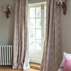 Susie Watson Designs - Susie Watson Designs Fabric Collection - White floor-length curtains with fringed edges and a simple floral paisley print, with patterned cushions and wall sconces Drapes And Blinds, Linen Curtains, Curtain Fabric, Linen Fabric, Hallway Curtains, Lounge Curtains, Curtain Trim, Pom Pom Curtains, Cottage Curtains