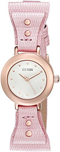 GUESS Women's U0736L6 Feminine Pink Bow-Tie Watch with Genuine Leather Strap. Round watch with rose gold-tone case, hands, and hour markers. 23 mm stainless steel case with mineral dial window. Quartz movement with analog display. Textured leather band with bow loops, rose gold-tone studs, and buckle closure.