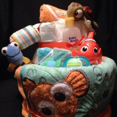 Finding nemo unisex diaper cake Includes finding Nemo  bath towel  2 Nemo wash cloths Shampoo nuk Pacifier Fish nail clippers Nuby bottle Nemo rattle stuff toy rubber Nemo toy Sign and of course diapers will be wrap in plastic with ribbon Other