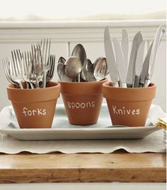 Fantastic way to display cutlery for a buffet, the pots would be easy enough to take the wait and you can use them in the garden after, nothing wasted! Perfect for a rustic, garden or country themed wedding