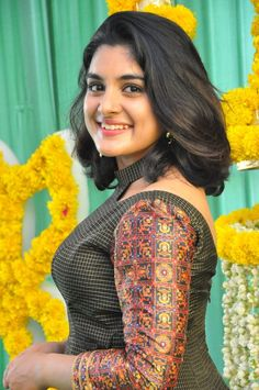 Nivetha Thomas at movie Muhurat. Nivetha Thomas Looking Beautiful in a Talasha Hyderabad long Dress, styled by Lavanya Bathina. Telugu actress Nivetha Thomas photos at her upcoming movie muhurat. New Designer Dresses, Fashion Designer, Indian Designer Wear, South Indian Actress, Beautiful Indian Actress, Beautiful Actresses, Beautiful Women, Beautiful Bride, Kurti Neck Designs