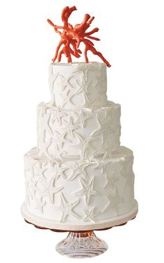 Starfish wedding cake with three-tiered fondant finish, sculpted sugar starfish and royal-icing coral