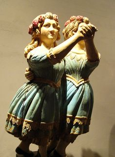Dancing girls, a whaling ship's masthead. Hand carved and painted wood