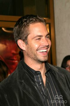 Laughing Paul Walker. Sure miss that smile!