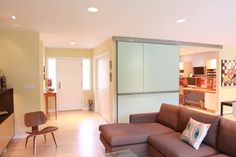 Contemporary entry. Large glass door opens to the office. Photo taken from the living room.