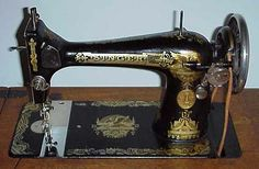 Singer 127 Sewing Machine with Sphinx Decals -- Not the treadle I use, but one I hope to restore one day.