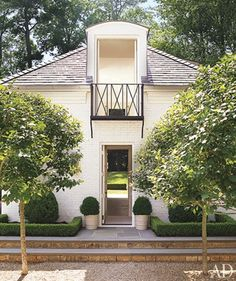 Gorgeous exterior of painted brick with black accents. Landscape with tress and boxwoods. Architectural Digest, Interior Exterior, Exterior Design, Modern Interior, Outdoor Spaces, Outdoor Living, Exterior Paint Combinations, Porte Cochere, Atlanta Homes
