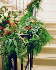 Festive garlands are wrapped around this staircase's banister for some winter flair