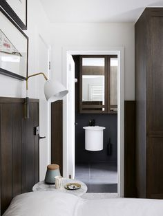 ensuite with black tapware + custom designed cabinet by Hecker Guthrie | the design files
