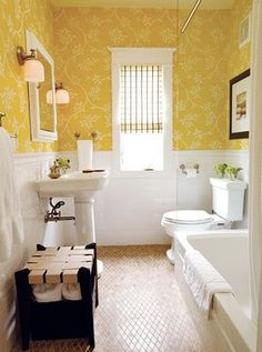 Love this color combo, very happy color which you want in the bathroom! This has wainscoting, and yellow fabric on the walls