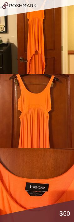 Bright Orange Bebe High-Low Dress Super hot and fun orange Bebe high-low dress, size small. Cut outs on side and back. Worn once, haven't worn since so someone else needs to rock it! 🔥 bebe Dresses Asymmetrical