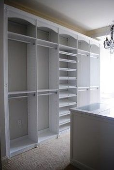 Master Dressing Room with Island, Shoe Fences & Rosettes - traditional - closet - baltimore - California Closets Maryland