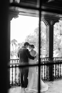 Classic Wedding With Modern Details at The Powel Crosley Estate in Sarasota, FL Captured by Sarah & Ben. Sparkly bow-tied Betsey Johnson Shoes, a flower-filled up do, a floral tie for the groom, JCrew bridesmaid dresses and a Cold Stone ice cream bar were just a few of our favorite details from this amazing wedding day! Make sure to check out so, so many more details!  You Can See More At: http://www.sarahbenblog.com/powel-crosley-estate-wedding-stephanie-jake/