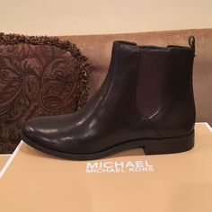 NEW BROWN LEATHER BOOTIES New, in box, brown leather booties. Super cute, have stretch and a gold button in the back. Michael Kors Shoes Ankle Boots & Booties