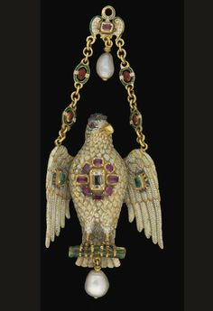 A GOLD, ENAMELLED, PEARL AND SEMI PRECIOUS STONE PENDANT FORMED AS A PARROT PROBABLY FRENCH, 19TH CENTURY.