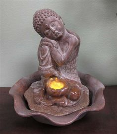 Welland Water Figurine Resting Sitting Buddha Fountain Great for Decor & Gifts Welland,http://www.amazon.com/dp/B00C7AWD9C/ref=cm_sw_r_pi_dp_.wPCtb1DJ81J7RER