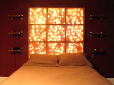 And another twinkle light headboard made with maple for the frame, frosted plexiglass and christmas lights. The frame is attached to a 2x4 that is attached to the wall