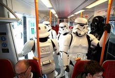 Stormtroopers take the bus. Love seeing Star Wars characters in everyday situations.