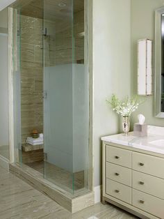 The frosted band on the glass shower door -- as well as on the toilet enclosure directly opposite -- adds privacy without making the space feel tight or confined.
