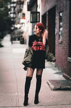 Black graphic long tee+black fishnet tights+black over the knee boots+khaki bomber jacket+gold necklaces. Style Outfits, Casual Fall Outfits, Mode Outfits, Grunge Outfits, Grunge Fashion, Trendy Fashion, Fashion Outfits, Trendy Style, Fashion Top