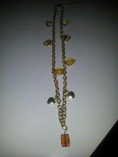 Collana in catenina color oro, pietre gialle e piccoli pendenti a cuore - Chain necklace in gold, yellow stones and small pendants heart