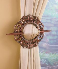 A Set of 2 Window Tie-Backs creates a different look for your existing curtains. The design features a circle with a coordinating stick. Gather the curtain in one hand, lay the circle over the front, then push the stick in on one side, behind the cur Curtain Tie Back Hooks, Curtain Tie Backs, Tuscan Design, Tuscan Style, Tuscan Curtains, Door Curtains, Tuscan Bathroom, Lakeside Collection, Rooms Home Decor