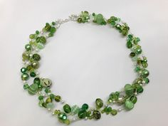 7 Strand Neon Yellow Bead Stringing Wire is the perfect accent to the various shapes and sizes of green beads in this multistrand necklace.