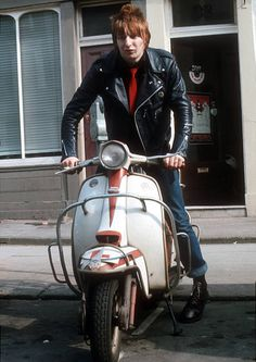 Rat Scabies of English punk group The Damned sits on a scooter during a portrait session in Notting Hill in west London March 1977 Ska Punk, Punk Goth, Scooters, The Damned Band, British Punk, Music Licensing, Skinhead, The Clash, West London