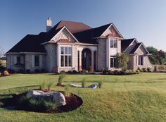You'll be charmed by this impressive home, with its stone-and-brick exterior and two story great room.  House Plan # 161030.